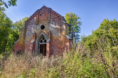 Forgotten chapel in the forest. Ruined and forgotten chapel with red bricks Royalty Free Stock Image