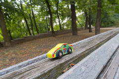 Forgotten children's toy on a bench royalty free stock images