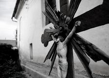 Forgotten christ. Small crucifix near an old catholic church in a small romanian village stock photos