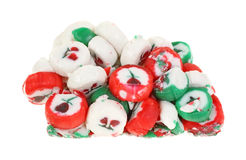 Forgotten Christmas Candy Past On White. A solid block of christmas candy melded together over the years Stock Image