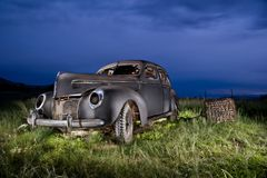 Forgotten Classic Ford. Forgotten old Classic ford automobile car light painted night sky Royalty Free Stock Photography