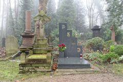 Cemetery grave stones, london. Forgotten grave stones on a misty day in an old Victorian cemetery in North London, uk stock images