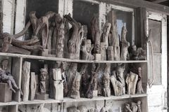 Forgotten handmade provincial wooden carved figures in an old ab Stock Images