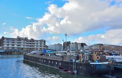 The forgotten harbor in Ghent, living boats and factories Royalty Free Stock Photos