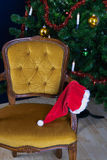 Forgotten hat from Santa Claus. Santa Claus left and forgot his hat on the chair Royalty Free Stock Image