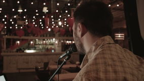 A forgotten musician sings for an empty restaurant stock video footage