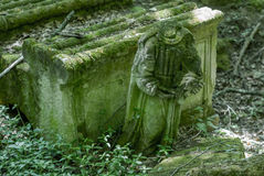 Forgotten old abandoned cemetery in the woods. Broken grave monu Stock Image