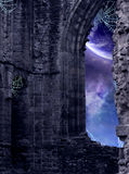 Forgotten Ruins. A corner of a ruined castle with a window looking out into the cosmos Royalty Free Stock Images