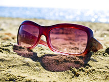 Forgotten sunglasses on the beach. Close-up image of sunglasses Royalty Free Stock Photography