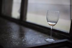 A forgotten wine glass stock photos