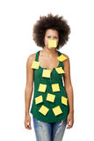 Forgotten woman. Beautiful young woman covered with post it notes all over the body, isolated on white background Stock Photo