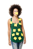 Forgotten woman. Beautiful young woman covered with post it notes all over the body, isolated on white background royalty free stock image