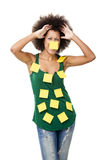 Forgotten woman. Beautiful young woman covered with post it notes all over the body, isolated on white background Royalty Free Stock Photos