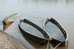 Forgotten wooden boats on the river Stock Image