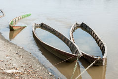 Forgotten wooden boats on the river Stock Photo