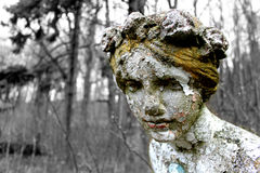 Forgotten in woods statue. Statue of sad lady found near Grodno Castle in Poland Stock Photo