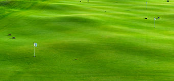 Fori e bunker sul campo da golf Fotografia Stock