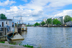 Fori ferry, in Turku. TURKU, FINLAND - JUNE 23, 2017: Scene of the Aura river, with a man waiting for the Fori ferry, in Turku, Finland Royalty Free Stock Photo