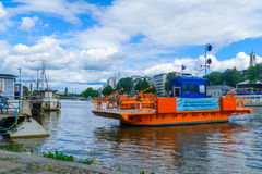 Fori ferry, in Turku. TURKU, FINLAND - JUNE 23, 2017: Scene of the Aura river, with the Fori ferry and passengers, in Turku, Finland Royalty Free Stock Photo