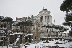 Fori Imperiali and altare della patria under snow. This picture was taken february 4th 2012, after one of the heaviest snowfall in Rome since 1985. This is the Stock Photo