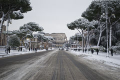 Fori Imperiali and Colosseum under snow. This picture was taken february 4th 2012, after one of the heaviest snowfall in Rome since 1985. This is the historic Stock Photo