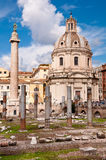 Fori Imperiali - Columns ruins  and Colonna Trajana and Chiesa d Royalty Free Stock Images