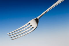 Fork. Metal fork on a blue background Stock Photography
