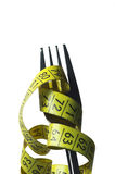 Fork. Centimetre, centimeter, measure, prong, crutch, fork, diet, eat, yellow, overweight Royalty Free Stock Photography