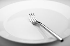 Fork. Photo of a fork on a white plate Stock Images