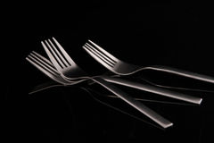 Fork. The forks in black background Royalty Free Stock Photography