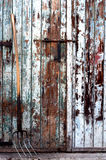 Fork. A fork tool in front of an old painted wooden farm door Stock Images