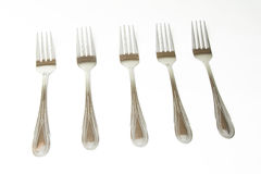 Fork. Five identical fork on a kitchen table Stock Photo