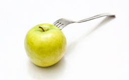 Fork in apple Royalty Free Stock Photo