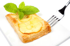 Fork and apple tart on a dish Royalty Free Stock Image