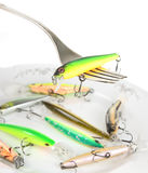 Fork with artificial fishing bait Royalty Free Stock Photography
