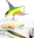 Fork with artificial fishing bait Royalty Free Stock Images