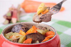 Fork with baked chicken liver, carrots and rhubarb Stock Photo