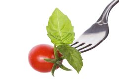 Fork with basil and tomato Stock Photo