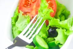 Fork,black olive,lettuce, tomato, cucumber and pepper Stock Photo