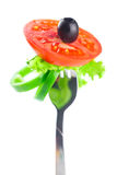 Fork,black olive,lettuce, tomato and pepper Royalty Free Stock Photos
