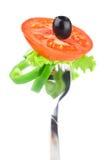 Fork,black olive,lettuce, tomato and pepper Stock Images