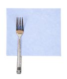 Fork on blue napkin Stock Photos