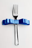 Fork with bow Royalty Free Stock Photo