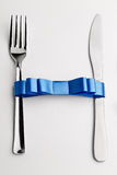 Fork with bow Royalty Free Stock Photography