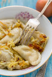 Fork in a bowl of dumplings. Royalty Free Stock Photo
