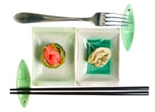 Fork and chopsticks with sushi and dumpling Royalty Free Stock Photo