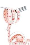 Fork con cinta métrica Foto de archivo