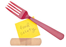 Fork con concepto de la seguridad alimentaria del vendaje Imagen de archivo