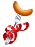 Fork con la salchicha tejido por la cinta roja Fotos de archivo libres de regalías