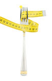 Fork with corn and measuring tape Stock Images